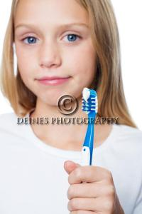 female portrait with toothbrush