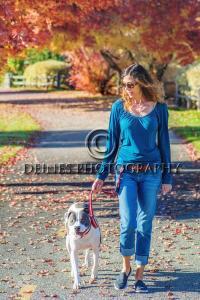 woman walking dog photograph